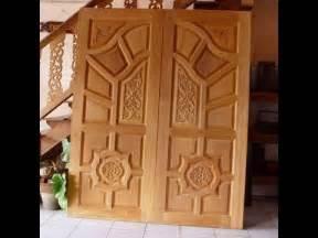 kerala style home front door design kerala style wood work front door designs 2 youtube