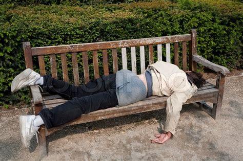 homeless jesus on park bench homeless unemployed man sleeping on bench in parisian park