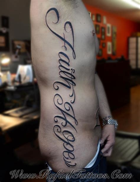 tattoo down ribs pain faith and hope in script down ribs by rafael marte