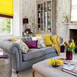 yellow purple bedroom: living room with grey sofa yellow blind purple lamp and floral