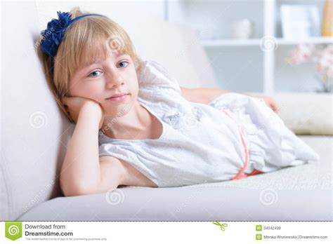 laying couch beautiful blue eyed girl stock image image of face