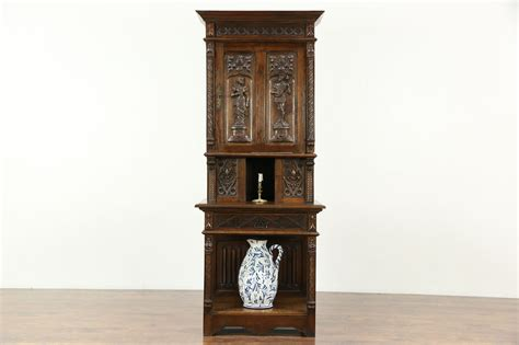sold french gothic antique  oak cabinet hand carved
