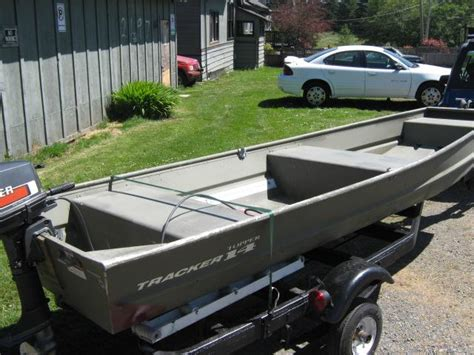 14 ft jon boat 14 ft tracker jon boat motor and trailer outside nanaimo
