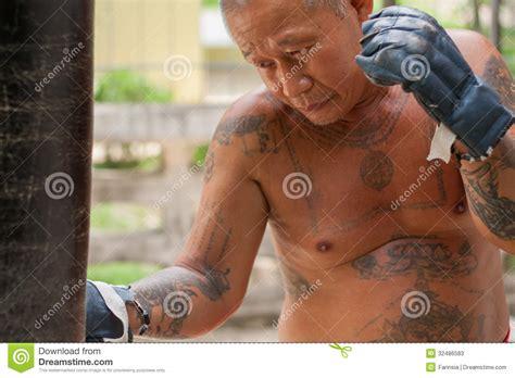 full body tattoo old man boxer hitting the sandbag stock image image of kickboxing
