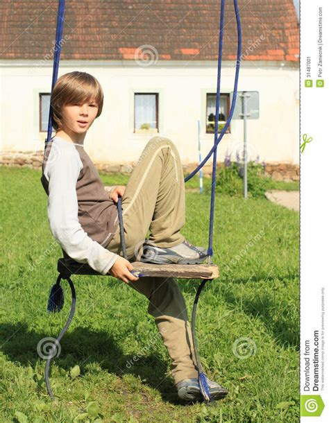 sitting swing little boy on a swing stock image image of playground