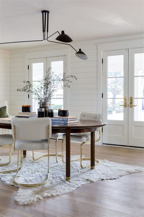 eclectic feeling dining room  dark wood oval table
