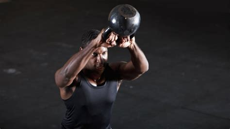 crossfit kettlebell swing 5 kettlebell workouts for a ripped summer physique