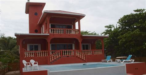 2 bedroom beachfront home for sale ambergris caye belize