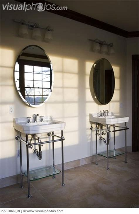 two bathroom sinks with exposed plumbing bathrooms