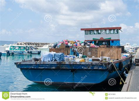 trash for boat boat loaded with trash at docks area editorial stock photo