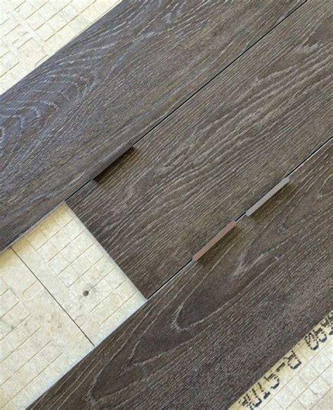this is what i want the tile wood combo in the entryway wood tile flooring the reveal brittanymakes