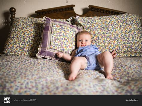 Propped Up Pillows baby propped up on bed pillows stock photo offset