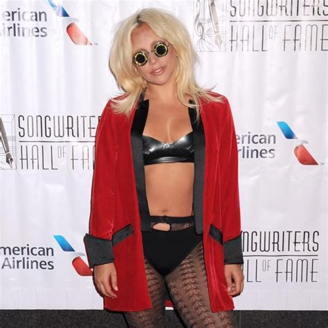 lady gaga accepts contemporary icon award in bra and lady gaga shows bra bra at songwriters hall of fame gala