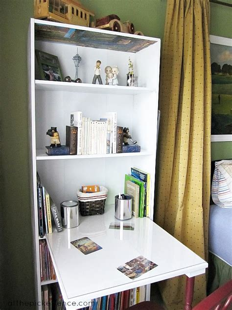 save on space by turning a bookcase into a desk here s