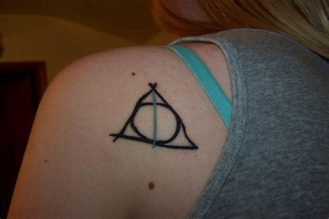deathly hallows foot tattoo pictures to pin on pinterest