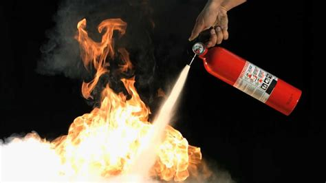 how to put out a fireplace motion extinguisher putting out flames with mo hd view of powder on