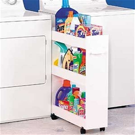 roll out laundry roll out laundry caddy nestles between washer and dryer in