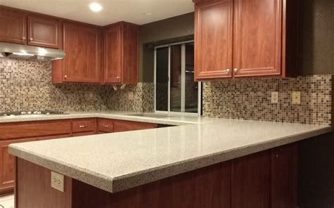 king ivory countertops cosmic mix mosaic backsplash