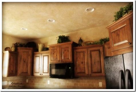 how to decorate the top of kitchen cabinets decorating ideas for top of kitchen cabinets house furniture