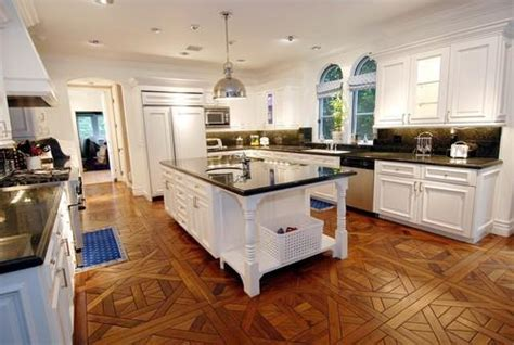 white kitchen cabinets with hardwood floors parquet wood floors transitional kitchen