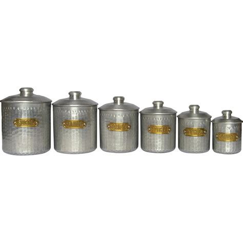set of dimpled aluminum vintage kitchen canisters