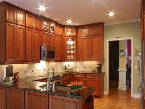 adding cabinets to existing kitchen add cabinets above existing cabinets for ceiling height
