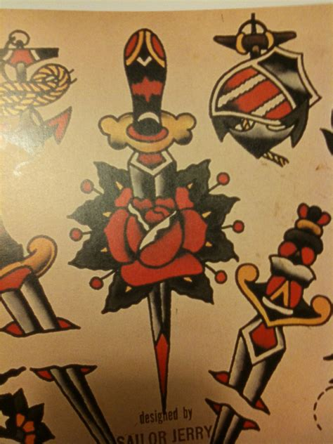 sailor jerry rose tattoo could always use more daggers especially cutting through