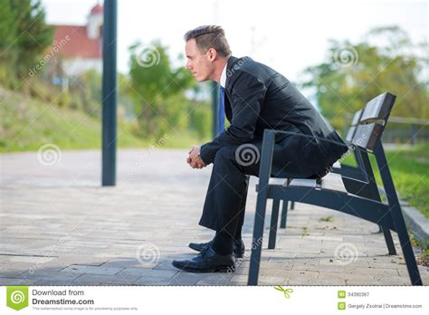 waiting on a bench businessman waiting on a bench in park royalty free stock