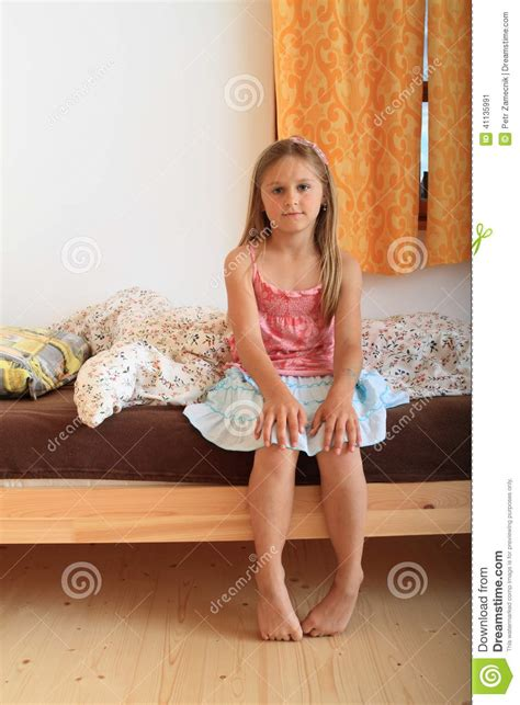 girl sitting on bed girl sitting on bed stock photo image 41135991