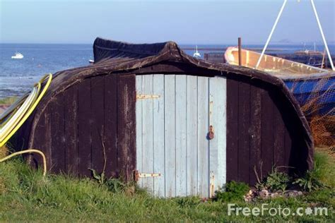 Fishing Sheds by Upturned Fishing Boat Used As A Work Shed Holy Island