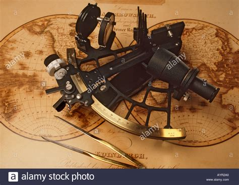 sextant age of exploration sextant and dividers on antique nautical chart stock photo
