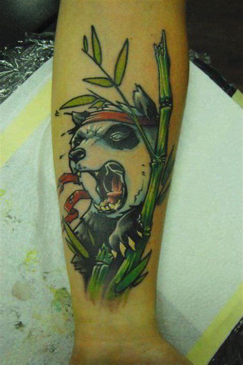 panda tattoo abstract tattoo artist jukan combines humor and animal symbolism in