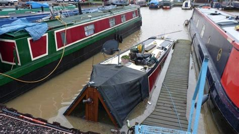 canal boat simulator pictures narrowboat sinks in high water after heavy
