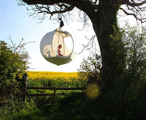 hanging tent spherical roomoon is a haven that hangs among the trees
