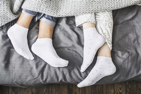 why you should wear socks to bed reader s digest