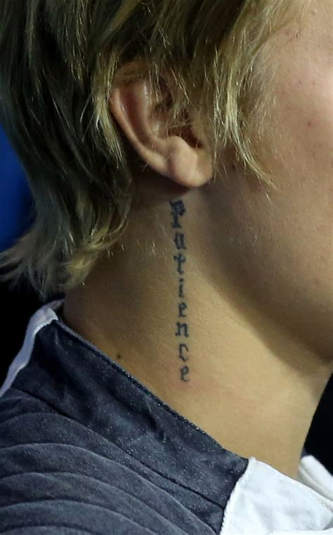justin bieber patience tattoo meaning justin bieber photos photos justin bieber celebrates