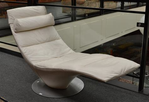 Natuzzi Chaise Lounge tennants auctioneers an italian natuzzi italian white leather swivel chaise lounge