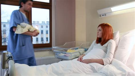 woman in hospital bed redhead women gets her newborn baby hd stock footage clip