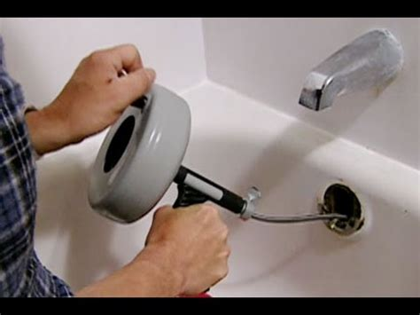 bathtub drain clog snake how to clear a clogged bathtub drain this old house