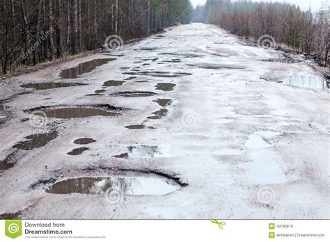 the broken road a novel the broken road series holes and puddles on bad broken road stock photo image