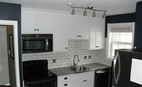 favorable small black and white kitchen design ideas with white wooden kitchen cabinet and