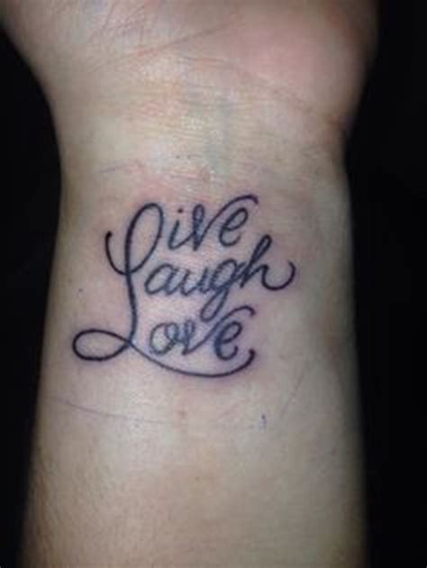 live tattoos 16 adorable live laugh wrist tattoos