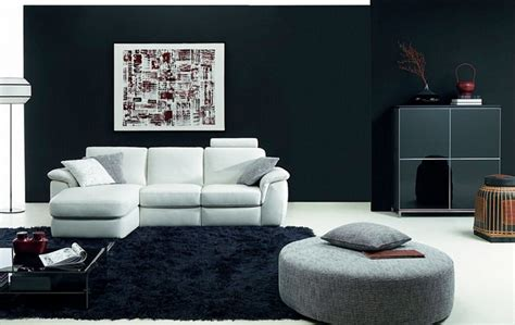 black livingroom furniture minimalist natussi java living room design with black wall paint white l shaped sofa black