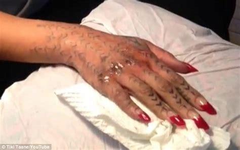 finger tattoo swelling rihanna grimaces as she gets a maori tribal tattoo inked