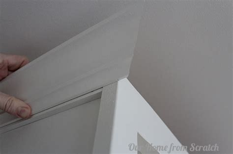 how to add crown molding the top of your cabinets young how to add trim to cabinets by our home from scratch