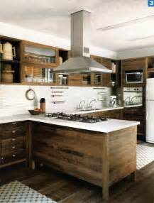 modern kitchen with raw wood cabinets white back splash