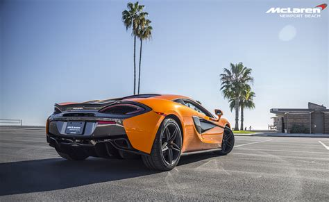 Orange Mclaren 570s In Newport Rear Side View