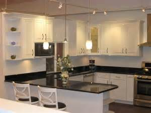 white ivory maple cabinets with black galaxy granite yelp - butcher block counter tops design ideas