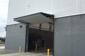 Residential Bi Fold Garage Doors Garage Doors And Openers From Fs Construction Services