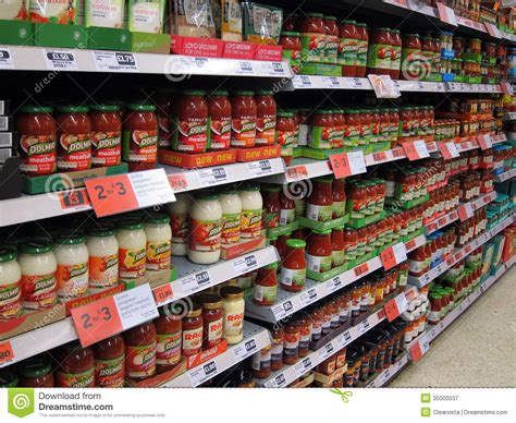Shelf Of Tomato Sauce by Pasta Sauces In Jars In A Store Editorial Photography